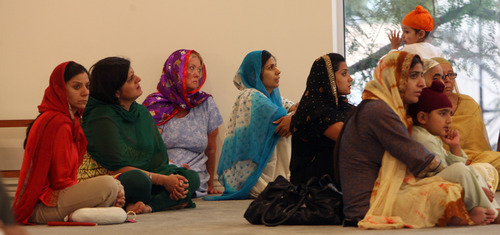 Steve Griffin | The Salt Lake Tribune   People attend a prayer service at the Sikh Temple of Utah, for the victims of the shooting at the Wisconsin Sikh Temple, in Taylorsville, Utah Wednesday August 8, 2012.