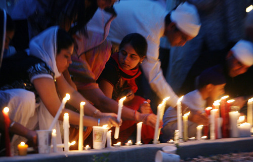 Steve Griffin | The Salt Lake Tribune    Members of the Sikh Temple of Utah, place their candles outside the temple during a candlelight vigil for the victims of the shooting at the Wisconsin Sikh Temple. The service was at the temple in Taylorsville, Utah Wednesday August 8, 2012.