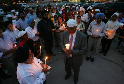 Steve Griffin | The Salt Lake Tribune    Members of the Sikh Temple of Utah, stand for a moment of silence outside the temple during a candlelight vigil for the victims of the shooting at the Wisconsin Sikh Temple. The service was at the temple in Taylorsville, Utah Wednesday August 8, 2012.