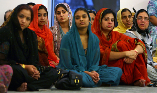 Steve Griffin | The Salt Lake Tribune   Women listen during a prayer service at the Sikh Temple of Utah, for the victims of the shooting at the Wisconsin Sikh Temple, in Taylorsville, Utah Wednesday August 8, 2012.