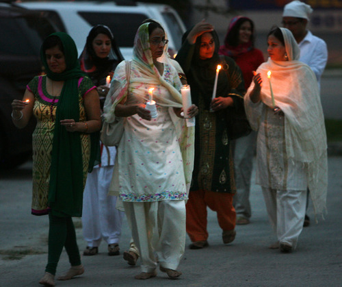Steve Griffin | The Salt Lake Tribune    Members of the Sikh Temple of Utah, walk outside the temple during a candlelight vigil for the victims of the shooting at the Wisconsin Sikh Temple. The service was at the temple in Taylorsville, Utah Wednesday August 8, 2012.