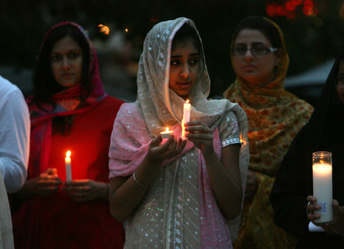 Steve Griffin | The Salt Lake Tribune    Members of the Sikh Temple of Utah, stand outside the temple during a candlelight vigil for the victims of the shooting at the Wisconsin Sikh Temple. The service was at the temple in Taylorsville, Utah Wednesday August 8, 2012.
