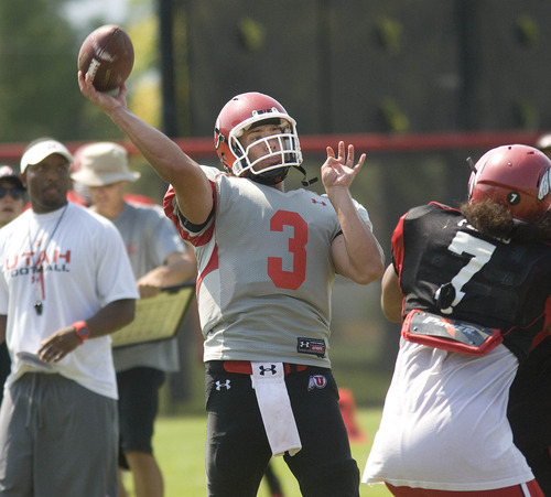 Paul Fraughton | Salt Lake Tribune  Utah quarterback Jordan Wynn throws at Tuesday's practice.  Tuesday, August 7, 2012