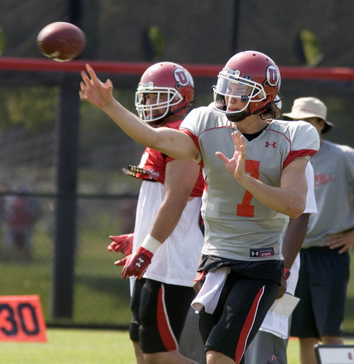 Paul Fraughton | Salt Lake Tribune Freshman quarterback Travis Wilson  throws during Tuesday's practice.  Tuesday, August 7, 2012