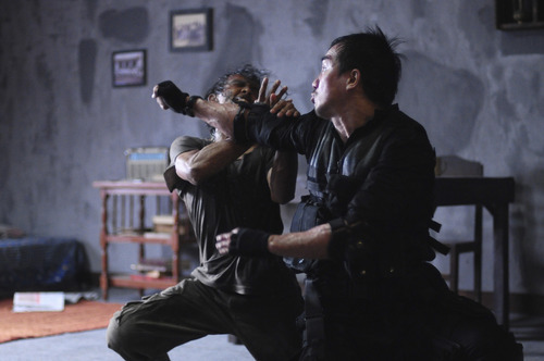Police Sgt. Jaka (Joe Taslim, right) battles the drug kingpin's guard Mad Dog (Yayan Ruhian) in