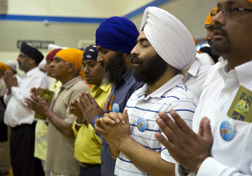 Mourners attend the funeral and memorial service for the six victims of the Sikh temple of Wisconsin mass shooting in Oak Creek, Wis., Friday, Aug 10, 2012. The public service was held in the Oak Creek High School. Three other people were wounded in the shooting last Sunday at the temple.  Wade Michael Page, 40, killed five men and one woman, and injured two other men. Authorities say Page then ambushed the first police officer who responded, shooting him nine times and leaving him in critical condition. A second officer then shot Page in the stomach, and Page took his own life with a shot to the head. (AP Photo/Jeffrey Phelps)
