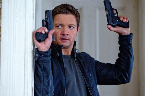 FILE - This publicity film image released by Universal Pictures shows Jeremy Renner, as Aaron Cross, in a scene from