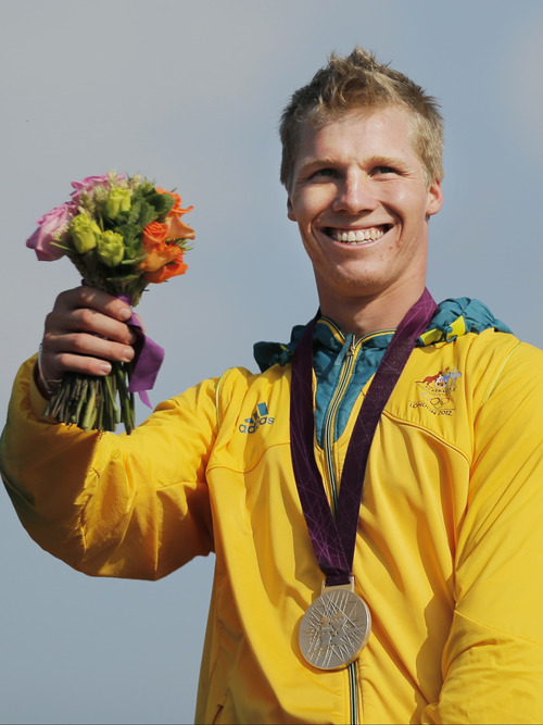 Australia's Sam Willoughby celebrates winning the silver medal after the men's BMX cycling event during the 2012 Summer Olympics in London, Friday, Aug. 10, 2012. (AP Photo/Christophe Ena)
