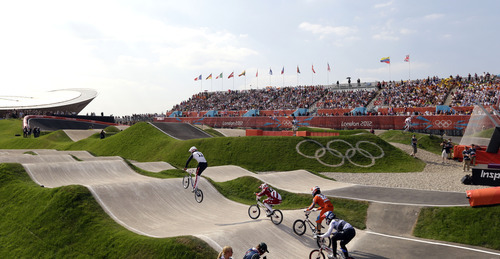 Cyclists compete in a BMX cycling women's event, during the 2012 Summer Olympics in London, Friday, Aug. 10, 2012(AP Photo/Matt Rourke)
