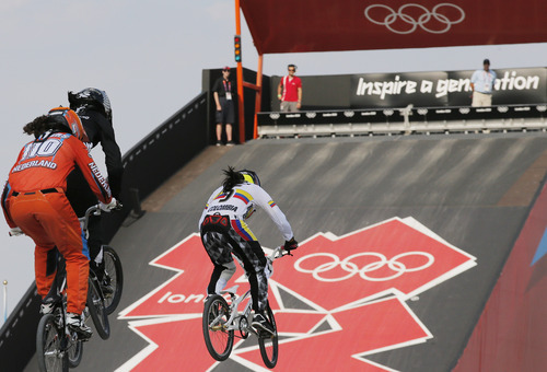 Colombia's Mariana Pajon, center, competes in the BMX cycling women's final run during the 2012 Summer Olympics in London, Friday, Aug. 10, 2012. Pajon, a former world champion, has won the women's BMX competition at the London Olympics, giving Colombia its first gold of the games.(AP Photo/Christophe Ena)