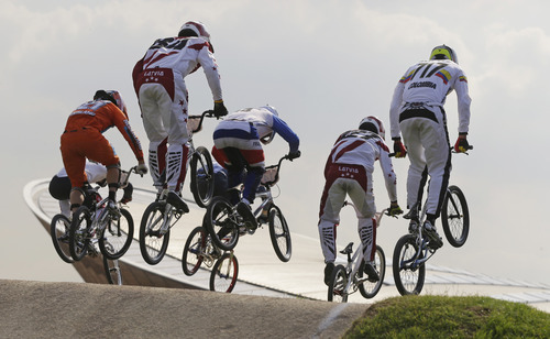 Cyclists compete in a BMX cycling men's semifinal run at the 2012 Summer Olympics, Friday, Aug. 10, 2012, in London. (AP Photo/Sergey Ponomarev)