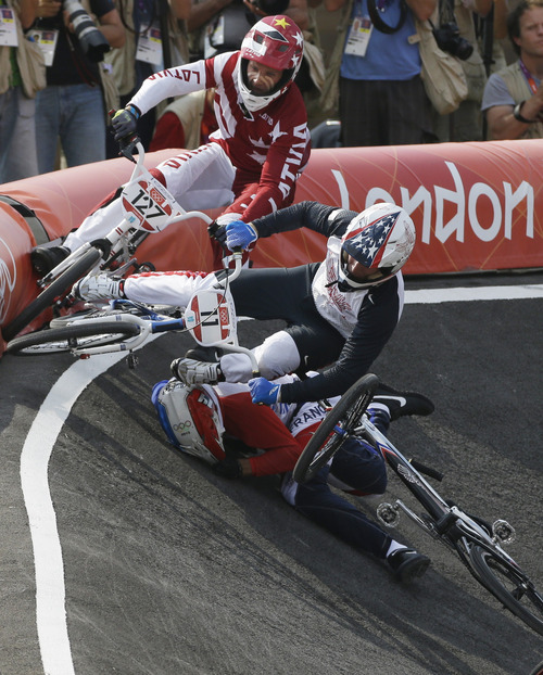 United States' Connor Fields  (11) crashes during a a BMX cycling men's semifinal run during the 2012 Summer Olympics, Friday, Aug. 10, 2012, in London. (AP Photo/Matt Rourke)