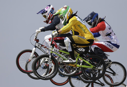 United States' Alise Post (8) and Australia's Caroline Buchanan (68) compete in a BMX cycling women's semifinal run during the 2012 Summer Olympics, Friday, Aug. 10, 2012, in London. (AP Photo/Matt Rourke)