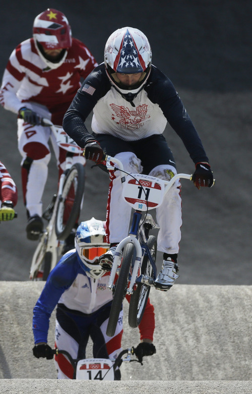 United States' Connor Fields  (11) competes in a BMX cycling men's semifinal run during the 2012 Summer Olympics, Friday, Aug. 10, 2012, in London. (AP Photo/Matt Rourke)