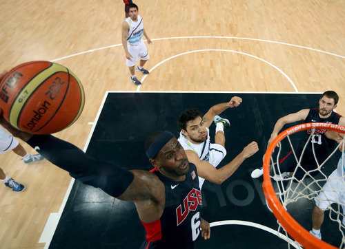 Christian Petersen   The Associated Press LeBron James of the United States goes up for a dunk over Argentina's Carlos Delfino. James finished with 18 points.