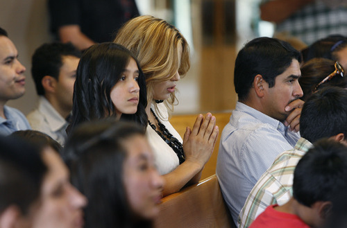 Scott Sommerdorf     The Salt Lake Tribune              Catalina Portillo prays during service at Immaculate Conception Catholic Church in Lafayette, Colo. She is not yet a citizen, so cannot vote. Her husband Jaime Portillo leans toward Obama but with a growing family and extra hours at work, he's not sure he'll have time to participate in the election.