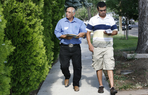 Scott Sommerdorf  |  The Salt Lake Tribune              Joe Perez, left, walks along with Rudy Garcia as they try to get residents to register to vote in Greeley, Colo. Perez says the trick is persistence -- and he has been at it for months.
