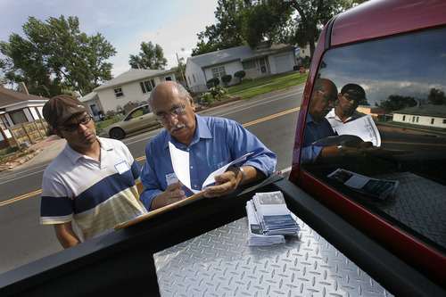Scott Sommerdorf     The Salt Lake Tribune              Joe Perez, right, plans their route with Rudy Garcia as they try to get residents to register to vote in Greeley, Colo. Perez has spent months working for the Obama campaign, trying to get Latino voters in this important swing state to registar to vote.