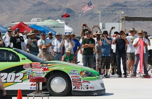 Trent Nelson  |  The Salt Lake Tribune Spectators take photographs at the starting line at the 64th annual Speed Week at the Bonneville Salt Flats, Utah Saturday, August 11, 2012.