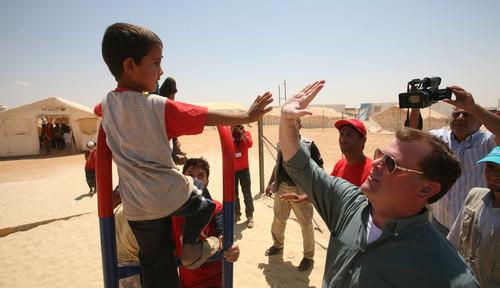 Canadian Foreign Affairs Minister John Baird greets a Syrian refugee boy s at Zaatari refugee camp,  in Mafraq, Jordan, Saturday, Aug. 11, 2012.  (AP photo/Mohammad Hannon)