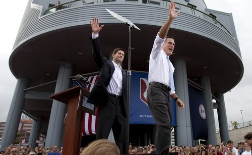 Republican presidential candidate, former Massachusetts Gov. Mitt Romney, right, introduces his vice presidential running mate, Wisconsin Rep. Paul Ryan, Saturday, Aug. 11, 2012 in Norfolk, Va. (AP Photo/Virginian-Pilot, L. Todd Spencer)  MAGS OUT