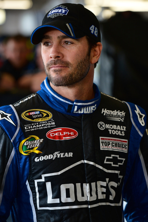 Jimmie Johnson watches his team before practice for the NASCAR Sprint Cup Series auto race at Watkins Glen International, Friday, Aug. 10, 2012, in Watkins Glen, N.Y. (AP Photo/Autostock, Brian Czobat) MANDATORY CREDIT