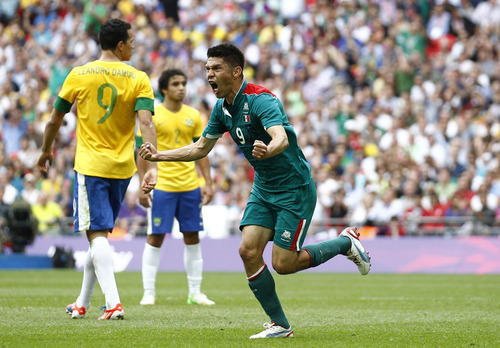 Jon Super | The Associated Press Mexico's Oribe Peralta, right, celebrates in front of Brazil's Leandro Damiao, left, during the men's soccer final at the 2012 Summer Olympics, Saturday, Aug. 11, 2012, in London. (AP Photo/Jon Super)