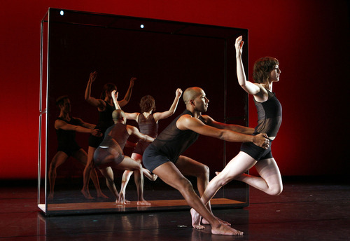Francisco Kjolseth  |  The Salt Lake Tribune Dancers Caine Keenan and Elizabeth Kelley, behind glass left, Jo Blake and Tara McArthur perform in rehearsal for Ririe-Woodbury's 2010 program,