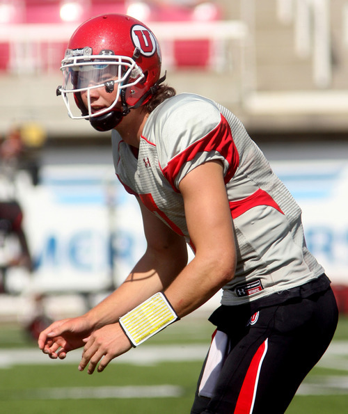 Steve Griffin | The Salt Lake Tribune   Utah quarterback Travis Wilson calls a play during a scrimmage Aug. 9, 2012.