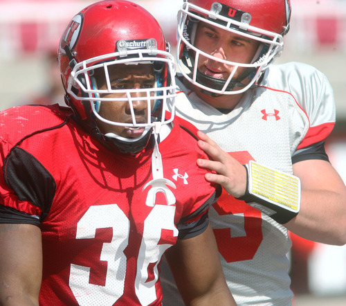 Steve Griffin | The Salt Lake Tribune   Utah quarterback Jon Hayes congratulates running back Jarrell Oliver after Oliver scored a touchdown during a scrimmage Aug. 9, 2012.