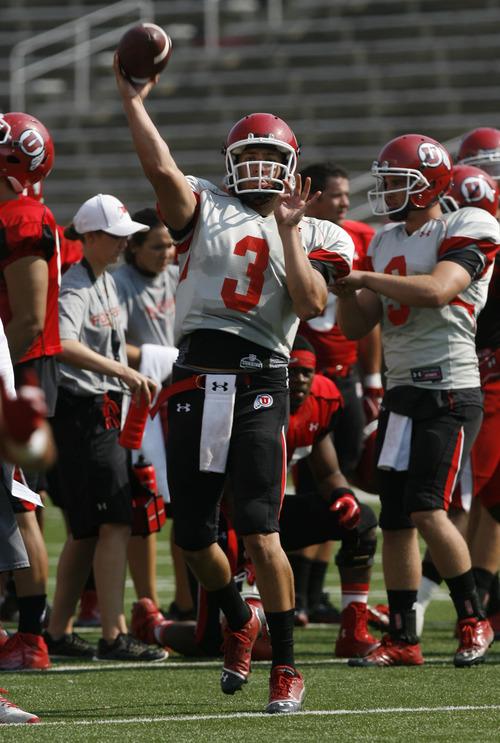 Francisco Kjolseth     The Salt Lake Tribune Jordan Wynn looks for an opening as the Utah football team practices on Wednesday, August 8, 2012.
