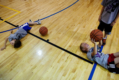 Kids practice basketball drills during the Jimmer Jam Camp on Wednesday, Aug. 8, 2012, in Lehi, Utah. (AP Photo/Daily Herald, Mark Johnston)
