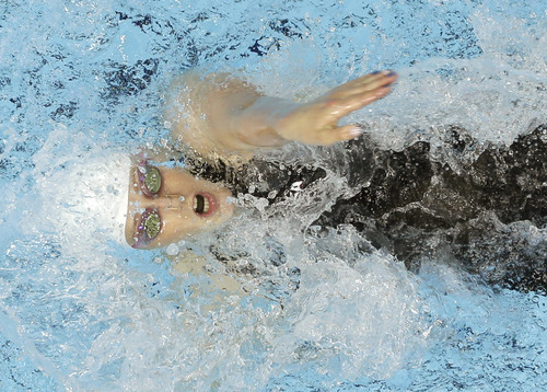 United States' Missy Franklin competes in a women's 100-meter backstroke swimming heat at the Aquatics Centre in the Olympic Park during the 2012 Summer Olympics in London, Sunday, July 29, 2012. (AP Photo/Mark Duncan)