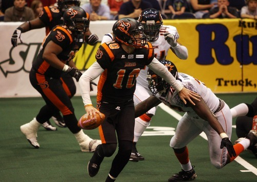 Kim Raff   The Salt Lake Tribune Utah Blaze quarterback Tommy Grady scrambles away from Spokane Shock player Jonathan Williams during a game at the EnergySolutions Arena in Salt Lake City, Utah on May 4, 2012.