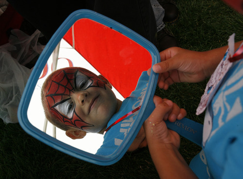 Scott Sommerdorf  |  The Salt Lake Tribune              Alexander Aparico checks out his new Spiderman facepaint look in the mirror at the Back to School
