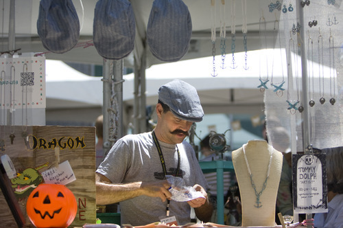 Kim Raff   The Salt Lake Tribune Artist Tommy Dolph makes a necklace during the 4th annual Craft Lake City Utah's DIY Festival at the Gallivan Center in Salt Lake City, Utah on August 11, 2012.