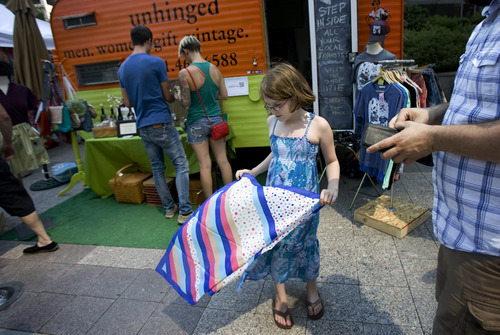 Kim Raff   The Salt Lake Tribune Daphne Pinette looks at a scarf that her father purchased for her at the Unhinged booth during the 4th annual Craft Lake City Utah's DIY Festival at the Gallivan Center in Salt Lake City, Utah on August 11, 2012.