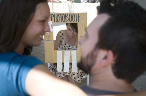 Kim Raff   The Salt Lake Tribune (left) Angelina Starks and (right) Johnny Prime have a hand drawn photo booth picture made by artist (middle) Natalie Allsup-Edwards during the 4th annual Craft Lake City Utah's DIY Festival at the Gallivan Center in Salt Lake City, Utah on August 11, 2012.
