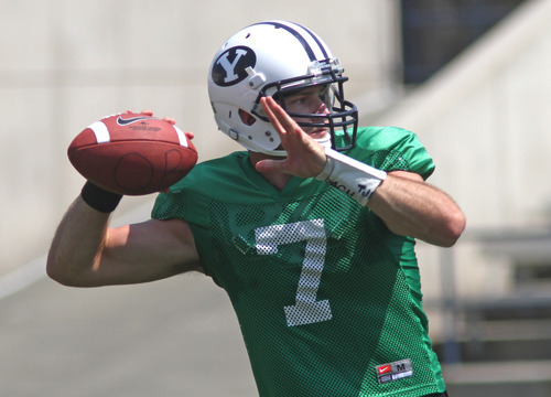 Rick Egan  | The Salt Lake Tribune   Quarterback James Lark (7) looks for an open man down field, during the scrimmage at LaVell Edwards StadiumThursday, August 9, 2012.