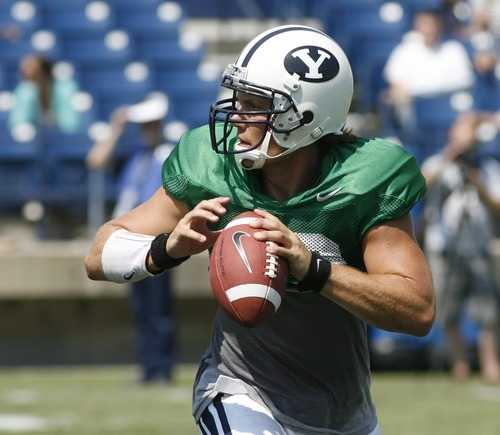 Rick Egan  | The Salt Lake Tribune   Quarterback Riley Nelson (13) scrambles as he looks for an open man down field, during the scrimmage at LaVell Edwards StadiumThursday, August 9, 2012.