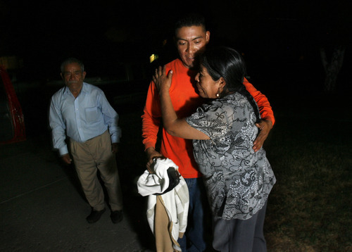 Scott Sommerdorf  |  The Salt Lake Tribune              Flora Soriano hugs her son Julian at 1:30 a.m. as he is about to leave for a construction job three hours away in California. He and his brother Mauro both face short sales on their homes in Sparks, Nev. Julian's father Gonzalo is at left.