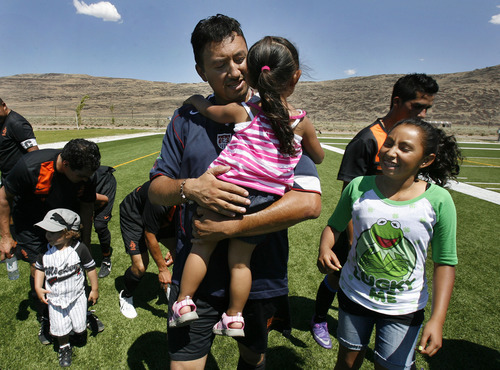 Scott Sommerdorf  |  The Salt Lake Tribune              Realtor Nico Moreno attends a soccer game with his family in Sparks, Nev. Like many others in Washoe County, the Morenos lost their home in a foreclosure.