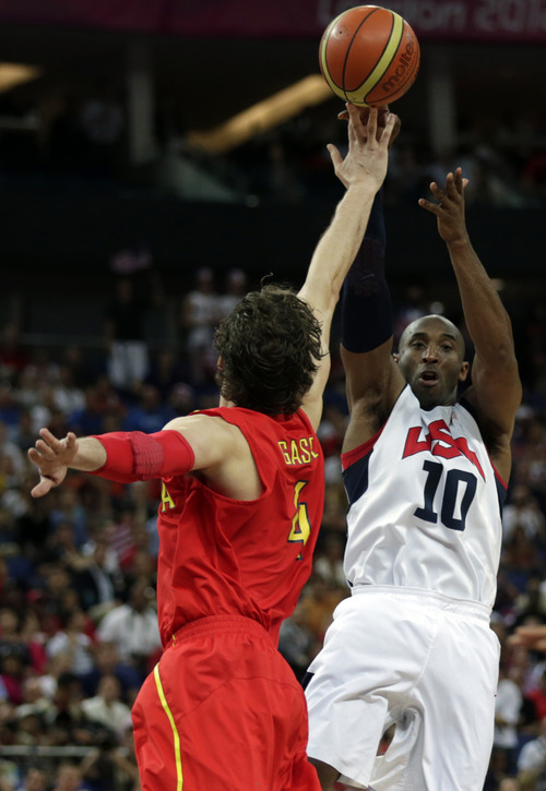 United States' Kobe Bryant shoots over Spain's Pau Gasol during the men's gold medal basketball game at the 2012 Summer Olympics, Sunday, Aug. 12, 2012, in London. (AP Photo/Charles Krupa)