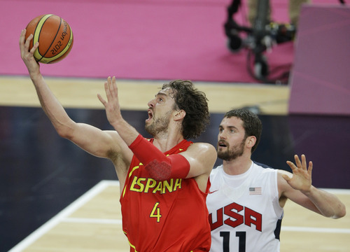 Spain's Pau Gasol puts up a shot against United States' Kevin Love during the men's gold medal basketball game at the 2012 Summer Olympics, Sunday, Aug. 12, 2012, in London. (AP Photo/Matt Slocum)