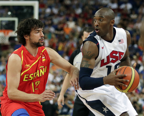 United States' Kobe Bryant tries to drive on Spain's Sergio Llull during the men's gold medal basketball game at the 2012 Summer Olympics, Sunday, Aug. 12, 2012, in London. (AP Photo/Charles Krupa)