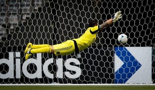 Real Salt Lake goalkeeper Nick Rimando allows a goal to Vancouver Whitecaps' Dane Richards during the second half of an MLS soccer game in Vancouver, British Columbia, on Saturday, Aug. 11, 2012. (AP Photo/The Canadian Press, Darryl Dyck)