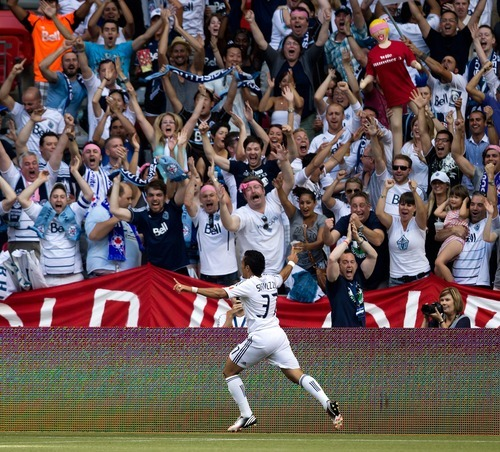 Vancouver Whitecaps' Camilo Sanvezzo, of Brazil, celebrates after scoring against Real Salt Lake during the second half of an MLS soccer game in Vancouver, British Columbia, on Saturday, Aug. 11, 2012. (AP Photo/The Canadian Press, Darryl Dyck)