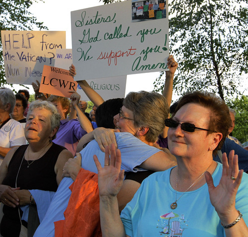 Supporters of The Leadership Conference of Women Religious participate in a vigil Thursday, Aug. 9, 2012 in St. Louis. The largest U.S. group for Roman Catholic nuns meet to decide how they should respond to a Vatican rebuke and order for reform. The LCWR, represents most of the 57,000 American nuns. (AP Photo/Seth Perlman)