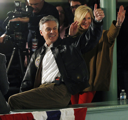 File  |  The Associated Press Former Utah Gov. Jon Huntsman says he agrees with his father Jon Huntsman Sr. that Mitt Romney should release more tax returns -- the same as candidates for positions in the executive branch. In this file photo, Huntsman and his wife were on the campaign trail in New Hampshire during Huntsman's brief presidential run. He since has endorsed Romney.