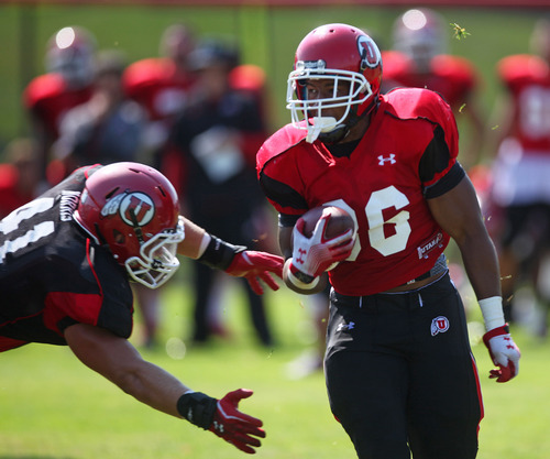 Lennie Mahler  |  The Salt Lake Tribune Utah running back Jarrell Oliver rushes the ball in a practice scrimmage Saturday, Aug. 11, 2012.
